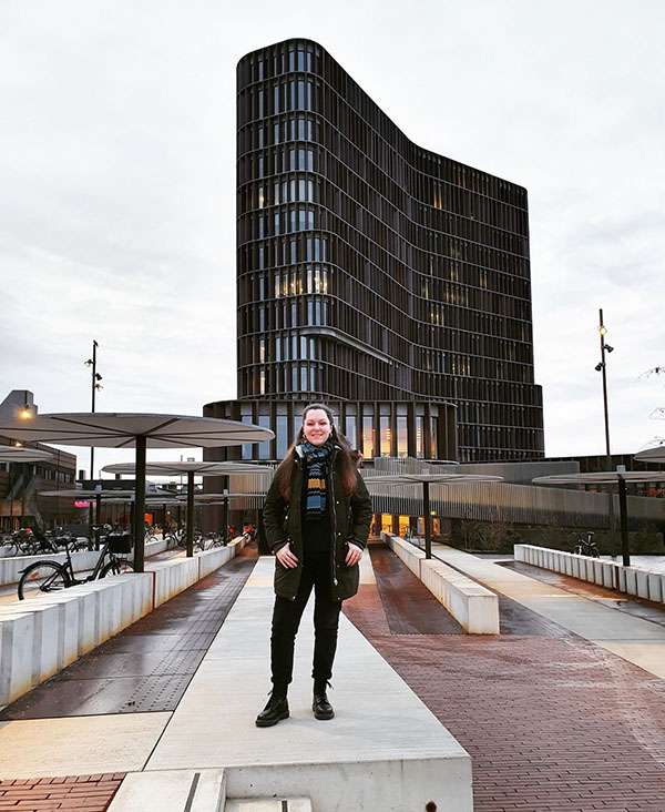 Fiona stands outside the University of Copenhagen's Maersk Tower. CBMR occupies the 6th, 7th and 8th floors.