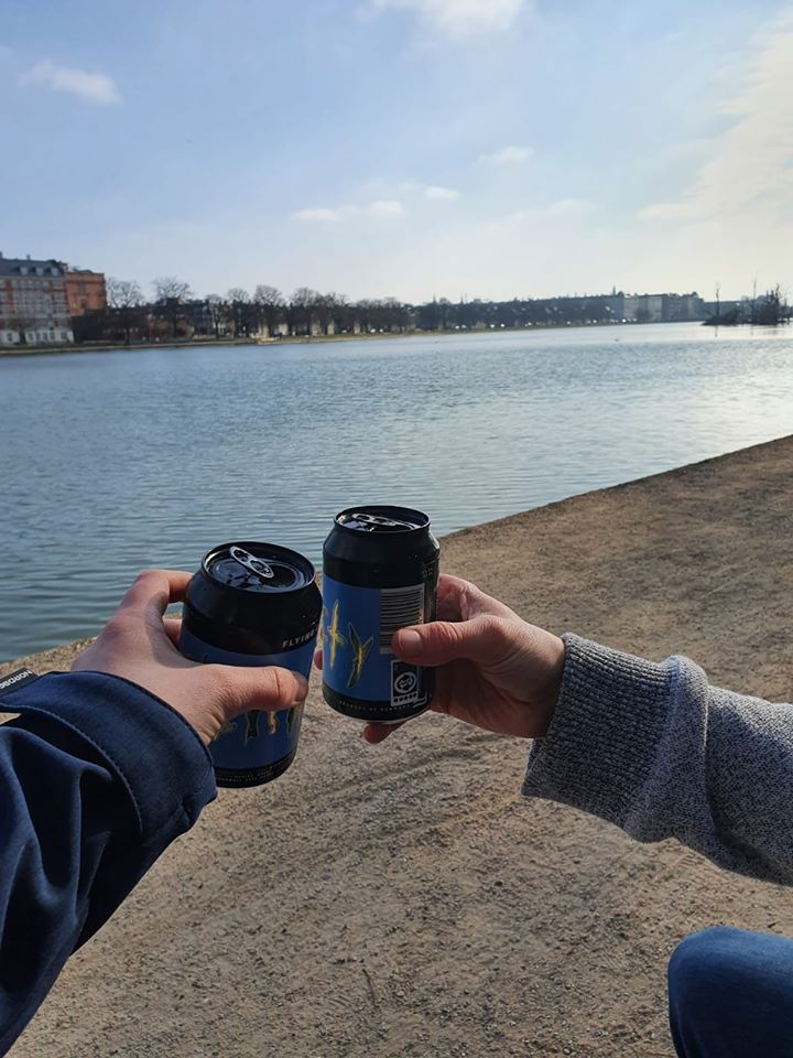 A photo of Greg drinking a beer by Copenhagen's inner city lakes.